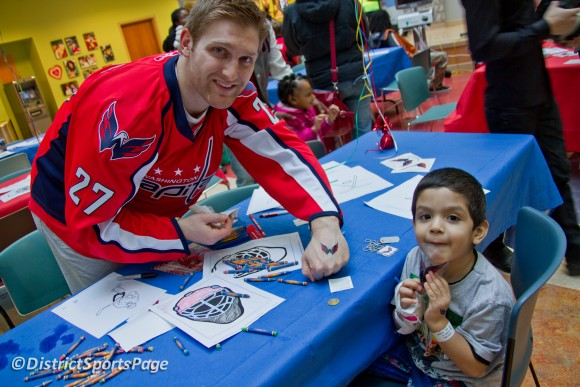 Capitals Karl Alzner and young patient showing off matching Weagle tattoos at Children's Hospital Feb. 27 (Photo by Cheryl Nichols)