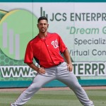 Gio Gonzalez stretching before start. Wonder what he is listening to on his iPod. (Cheryl Nichols/District Sports Page)