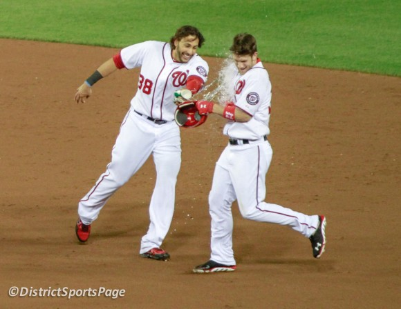 Michael Morse douses Bryce Harper after his first MLB walkoff! 6/5/2012 (Cheryl Nichols/District Sports Page)