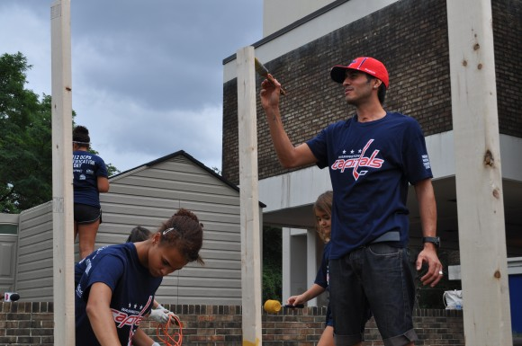 Capitals forward Mike Ribeiro paints a garden box at Thurgood Marshall Elementary School in Washington, D.C., as part of the 2012 DCPS Beautification Day. (Photo Courtesy of Washington Capitals)