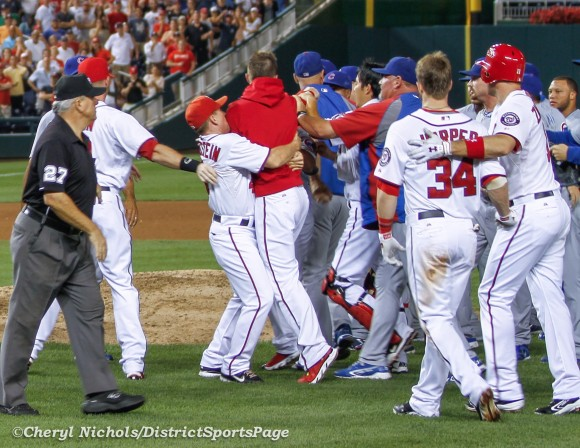 Nats Hitting Coach Rick Eckstein holding relief pitcher Sean Burnett back and Ryan Zimmerman with Bryce Harper during brawl #2 - Chicago Cubs v Washington Nationals, 9/6/2012. (Cheryl Nichols/District Sports Page)