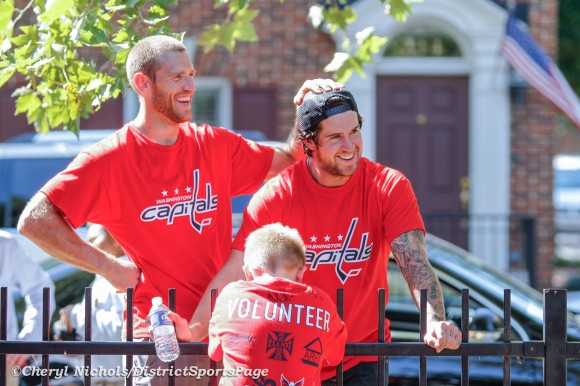 Something made Caps Brooks Laich and Mike Green laugh while chatting wth volunteer Connor (age 7) - Washington Capitals and So Kids Can partnered with KaBOOM! and ARHA to replace the playground at S.T.A.R.S. Playground at Hopkins-Tancil Court in Old Town Alexandria, September 13, 2012 (Cheryl Nichols/District Sports Page)