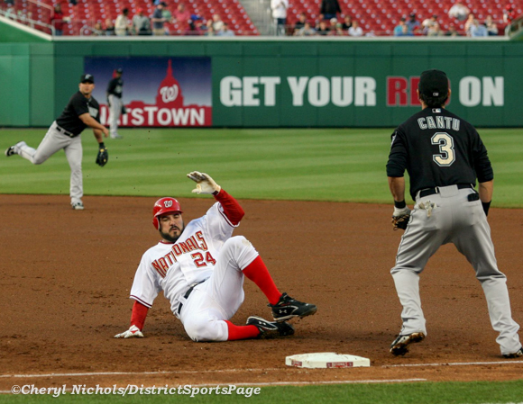 Former National 1B Nick Johnson sliding back for first base, 4/17/2009 (Cheryl Nichols/District Sports Page)