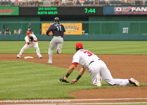 1B Michael Morse gets the throw to SS Ian Desmond to get Justin Smoak out at 2B - Seattle Mariners v. Washington Nationals, 6/21/2012. (Cheryl Nichols/District Sports Page)