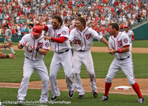 Michael Morse, Jayson Werth and Ryan Zimmerman congratulating Laynce Nix on walk-off win  - Seattle Mariners v. Washington Nationals, 6/23/2012. (Cheryl Nichols/District Sports Page)