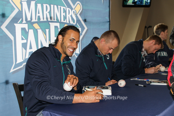 Michael Morse, Kyle Seager and Michael Saunders sign autographs for fans at Mariners FanFest at Safeco, 1/26/2013 - Former National Michael Morse returns to the Seattle Mariners and welcomed back by fans (Cheryl Nichols/District Sports Page)