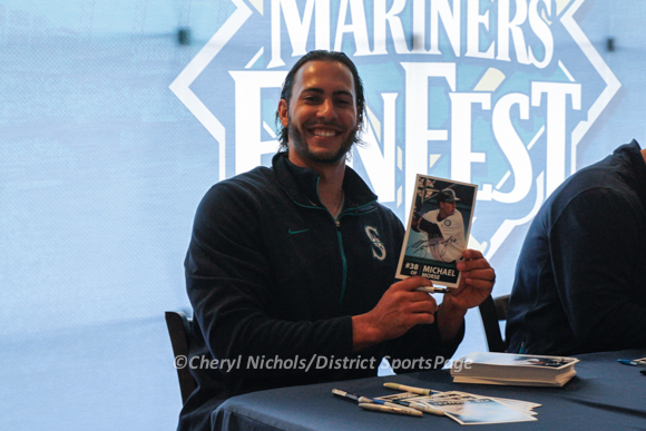 Former National Michael Morse signed his 2005 Mariners photo for fans at Mariners FanFest at Safeco, 1/26/2013 (Cheryl Nichols/District Sports Page)