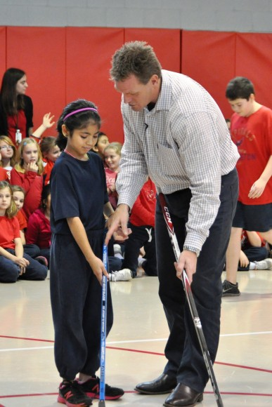 Washington Capitals assistant coach Calle Johansson instructs a Blessed Sacrament School student on stickhandling during a Hockey School clinic. The visit marked the Capitals seventh Hockey School assembly of the 2012-13 school year. (Photo Courtesy of Washington Capitals)