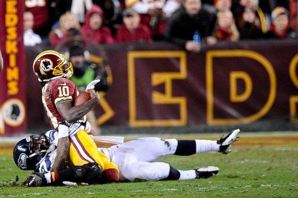 One of the many times Robert Griffin III ended up on the ground, wincing. (photo by Brian Murphy)