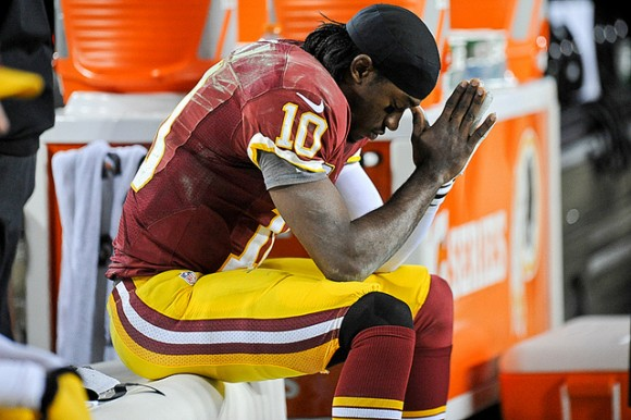 Robert Griffin III reflects on the sidelines in the waning moments of Redskins loss to Seattle in the playoffs. (photo by Brian Murphy)