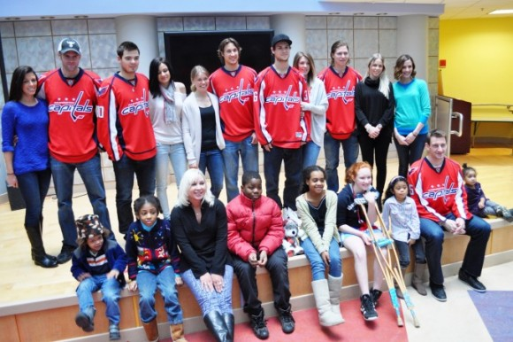 Following an afternoon of arts and crafts, Washington Capitals players and their better halves take a group photograph with patients at Children's National Medical Center. Back row (l-r): Jessica and Tom Poti, Michal Neuvirth and Monika Hybnerova, Ashley and Jay Beagle, Tomas Kundratek and Alannah Dzerdz, Nicklas Backstrom and Liza Berg, Mackenzie Schultz. Front row (l-r): Donna Oates, Jeff Schultz. (Photo Courtesy of Washington Capitals)