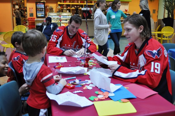 Washington Capitals forward Nicklas Backstrom (19) and defenseman Jeff Schultz (55) work on arts and crafts with patients at Children's National Medical Center during a Feb. 15 visit. Capitals players have made a tradition of visiting Children's National Medical Center each season since 1984. (Photo Courtesy of Washington Capitals)