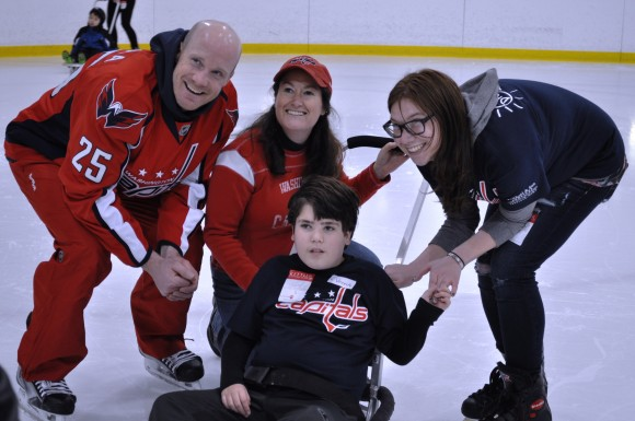 Washington Capitals forward Jason Chimera poses with participants during a Dreams for Kids Extreme Recess clinic at Kettler Capitals Iceplex on Feb. 8. Attended by 100 children, the event was held in conjunction with the Capitals celebration of Hockey is for Everyone™ Month, a league wide initiative that offers children of all backgrounds opportunities to play hockey. (Photo Courtesy of Washington Capitals)
