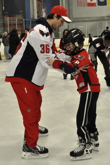 Washington Capitals defenseman Tomas Kundratek instructs a child on skating during a Dreams for Kids Extreme Recess clinic at Kettler Capitals Iceplex on Feb. 8. The session marked the third-consecutive year the Capitals have teamed up with Dreams For Kids for Extreme Recess. (Photo Courtesy of Washington Capitals)