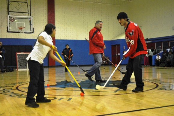 Washington Capitals forward Mike Ribeiro instructs a Meridian Public Charter School student on passing during a Hockey School program at the Rita Bright Family and Youth Center in northwest Washington, D.C. on Feb. 20. (Photo Courtesy of Washington Capitals)