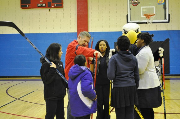 Washington Capitals alumnus and Comcast SportsNet color commentator Craig Laughlin prepares his team for a scrimmage during a Hockey School assembly at the Rita Bright Family and Youth Center in northwest Washington, D.C. on Feb. 20. (Photo Courtesy of Washington Capitals)