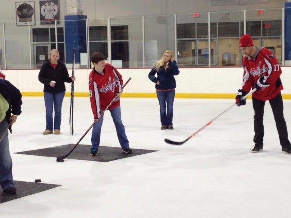 Wolski showing a guest the finer points of a wrist shot at Hockey 'N Heels, 1/18/2013. (photo courtesy K. Lucas)