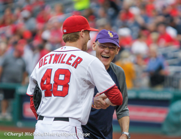 James Carville threw out the ceremonial first pitch to Nats lefty Ross Detwiler before the Atlanta Braves v. Washington Nationals, 8/21/2012. (Cheryl Nichols/District Sports Page)