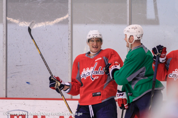 Alex Ovechkin and Jason Chimera celebrate a goal - Washington Capitals practice at Kettler, 3/28/2013 (Cheryl Nichols/District Sports Page)