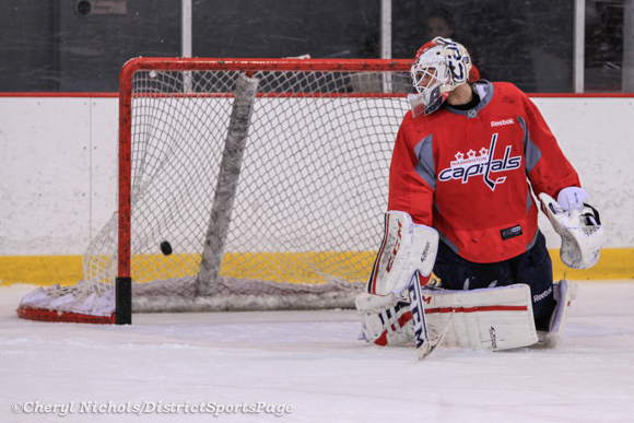 Braden Holtby watches a puck hit the back of the net - Washington Capitals practice at Kettler, 3/28/2013 (Cheryl Nichols/District Sports Page)