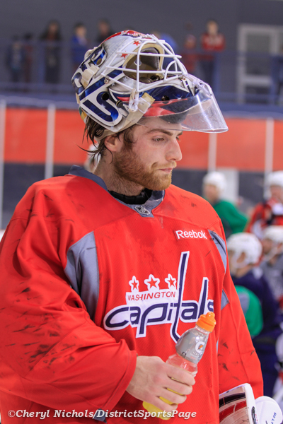 Goalie Braden Holtby during a break - Washington Capitals practice at Kettler, 3/28/2013 (Cheryl Nichols/District Sports Page)