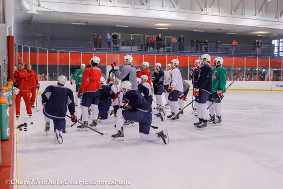 Meeting during Washington Capitals practice at Kettler, 3/28/2013 (Cheryl Nichols/District Sports Page)