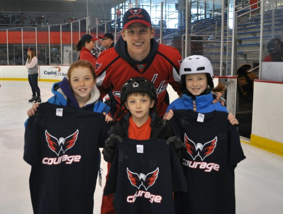 Washington Capitals forward Joey Crabb poses with children assisted by Tragedy Assistance Program for Survivors during a skating party at Kettler Capitals Iceplex in Arlington, Va. The event kicked off the 2012-13 Courage Caps, presented by SKYDEX technologies. 100% of proceeds raised through the sale of Courage Caps and T-Shirts will benefit TAPS. (Photo Courtesy of Washington Capitals)