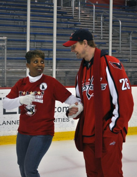 Washington Capitals forward Matt Hendricks skates with an adult assisted by Tragedy Assistance Program for Survivors during a skating party at Kettler Capitals Iceplex in Arlington, Va. The event kicked off the 2012-13 Courage Caps, presented by SKYDEX technologies. Courage Caps and Courage T-shirts will be sold for $20 online at WashingtonCaps.com, at the Washington Capitals Team Store at Kettler Capitals Iceplex and at the Team Store and at stands throughout Verizon Center during Capitals home games. (Photo Courtesy of Washington Capitals)