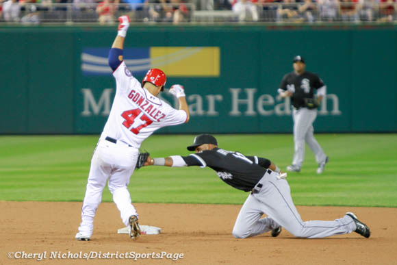 Photo 2 of 6: Gio  Gonzalez singles to right field, but tried to get the double. He repeated Bryce Harper from earlier in game. - Chicago White Sox v. Washington Nationals, 4/9/2013 (Cheryl Nichols/District Sports Page)