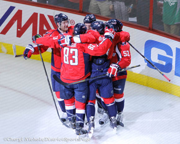 Alzner, Beagle, Wolski, Ovechkin gather around Mike Green to celebrate his goal - Carolina Hurricanes v. Washington Capitals, 4/11/2013 (Cheryl Nichols/District Sports Page)