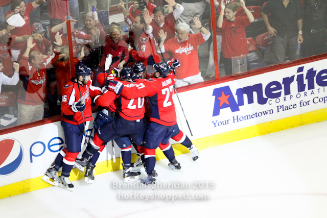 Caps celebrate after their game five overtime win in Washington, May 10, 2013 (Photo Courtesy of Brendan Sheridan/Hockeyshopped)
