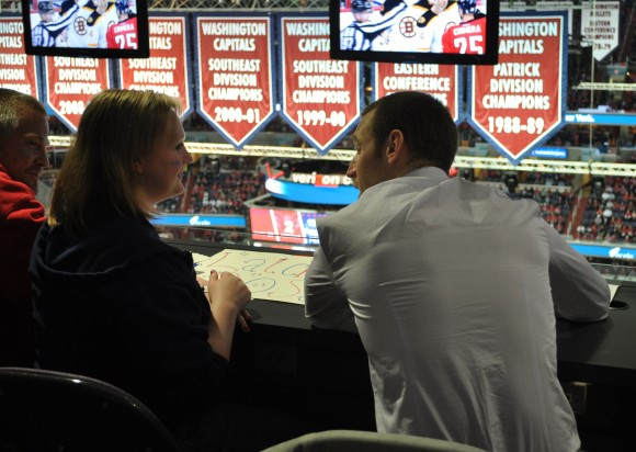 Washington Capitals forward Brooks Laich and Keymar Md., native Emily watch the Capitals versus Bruins game at Verizon Center on April 27. The Capitals and Make-A-Wish Mid-Atlantic partnered to make Emilys wish to attend a Capitals game and meet Laich come true. (Photo Courtesy of Washington Capitals)