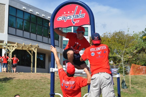 Washington Capitals forwards Aaron Volpatti, Tom Wilson and Jay Beagle assist with constructing a playground at Eagle Academy Public Charter School in Washington, D.C. The playground is the first built by KaBOOM! and Monumental Sports & Entertainment Foundation, but the third built with the assistance of the Washington Capitals. (Photo Courtesy of Monumental Sports)
