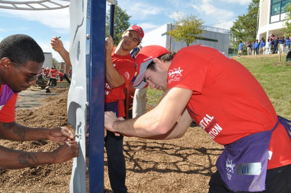 Washington Capitals forwards Aaron Volpatti and Tom Wilson assist with constructing a playground at Eagle Academy Public Charter School in Washington, D.C. Monumental Sports and Entertainment Foundation served as the funding partner for the playground, which cost $83,500. (Photo Courtesy of Monumental Sports)