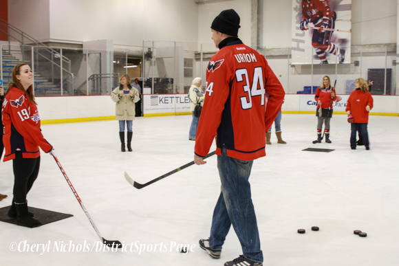 Alexander Urbom  instructed participants on skills including stickhandling and passing -  Washington Capitals Hockey 'N Heels, 11/13/2013 (Cheryl Nichols/District Sports Page)