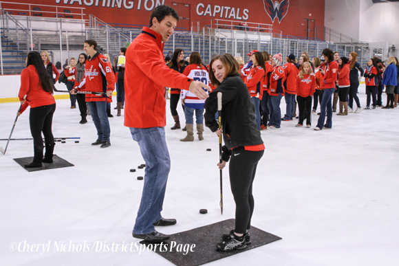 Former Capital and current Comcast analyst Alan May instructed women on shooting - Washington Capitals Hockey 'N Heels, 11/13/2013 (Cheryl Nichols/District Sports Page)