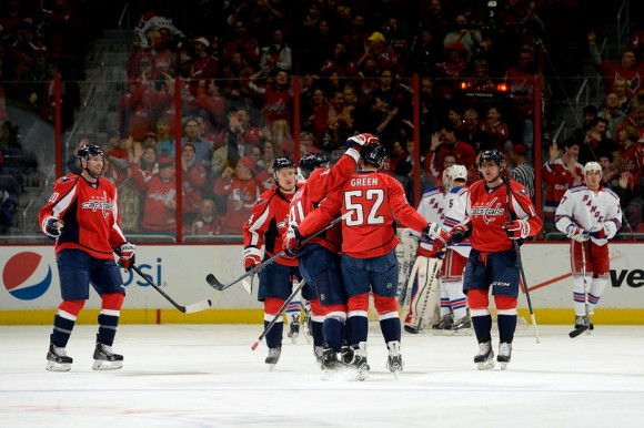 WASHINGTON, DC - DECEMBER 27: Mike Green #52 of the Washington Capitals celebrates after scoring a goal in the first period during an NHL game against the New York Rangers at Verizon Center on December 27, 2013 in Washington, DC. (Photo by Patrick McDermott/NHLI via Getty Images)