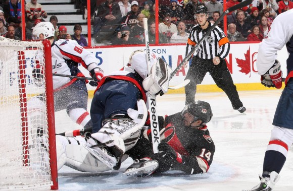 OTTAWA, ON - DECEMBER 30: Colin Greening #14 of the Ottawa Senators collides with goalie Philipp Grubauer #31 of the Washington Capitals during an NHL game at Canadian Tire Centre on December 30, 2013 in Ottawa, Ontario, Canada. (Photo by Jana Chytilova/NHLI via Getty Images)