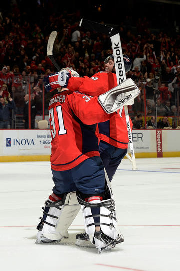 John Carlson congratulates Philipp Grubauer after the Capitals shootout victory. (Photo by Patrick McDermott/NHLI via Getty Images)