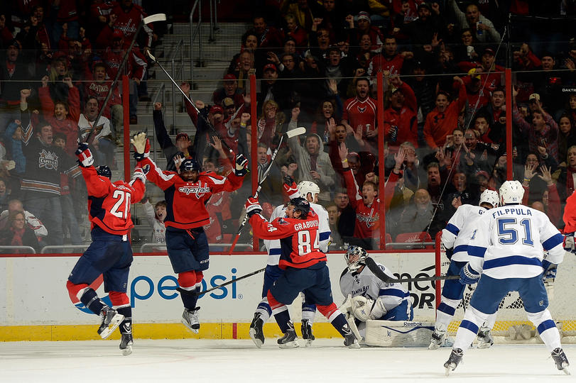 Joel Ward, Troy Brouwer and Mikhail Grabovski celebrate Alex Ovechkin's fourth goal of the game.(Photo by Patrick McDermott/NHLI via Getty Images)