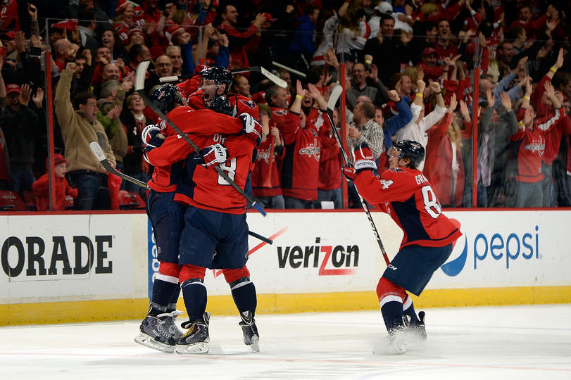 Ovechkin celebrates after scoring the game-tying goal, his fourth of the night. (Photo by Patrick McDermott/NHLI via Getty Images)