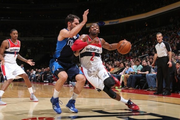 John Wall drives the baseline against the Dallas Mavericks Jan. 1, 2014 (photo courtesy Monumental Network)