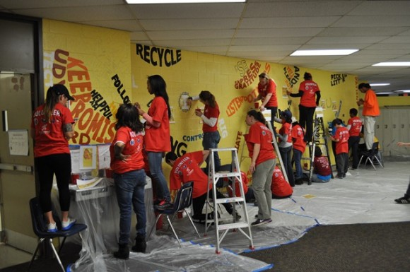 Volunteers working on a mural created by Susan Schwerin at West Education Campus during the MSE Foundation MLK Day of Service project.  (Photo Courtesy of Monumental Network)