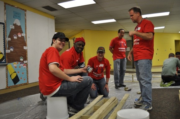 Capitals Hall-of-Famer Rod Langway working with volunteers during the MSE Foundation MLK Day of Service project. (Photo Courtesy of Monumental Network)