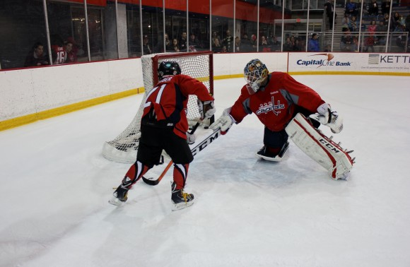 Braden Nienaber skates with Capitals goaltender Braden Holtby at Kettler Capitals Iceplex on Jan. 11. The 8-year-old's wish was to meet Holtby and also included a tour of the Capitals locker room and participation in a ceremonial puck drop, among other activities. (Photo Courtesy of Washington Capitals)