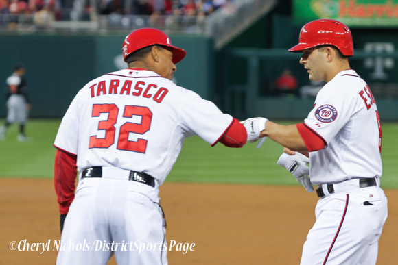 1B Coach Tony Tarasco congratulates Danny Espinosa after a hit - Miami Marlins v. Washington Nationals, 4/8/2014