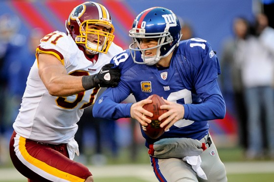 Ryan Kerrigan sacks Eli Manning in 2011. (photo by Brian Murphy)