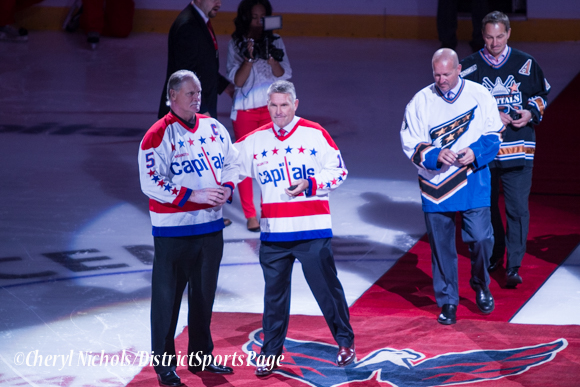 Former Capitals Rod Langway, Craig Laughlin, Sylvain Cote and Peter Bondra, wearing the jerseys they played in, to drop ceremonial puck before Washington Capitals home opener against Montreal featuring 40th Anniversary cermony, 10/09/2014 (Photo by Cheryl Nichols/District Sports Page)