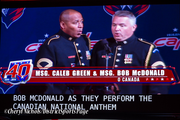 Caleb Green and Bob McDonald singing the Canadian National Anthem (featuring the new closed captioning on scoreboard) -Washington Capitals home opener against Montreal featuring 40th Anniversary cermony, 10/09/2014