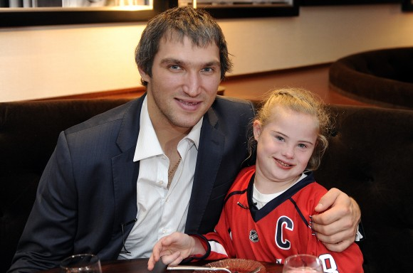 Washington Capitals captain Alex Ovechkin and 10-year-old Ann high-five during a sushi date at Verizon Center on Oct. 5. Ovechkin and Ann met on Sept. 11, during an American Special Hockey Association (ASHA) skate with 60 children and adolescents hosted by Ovechkin. During the session, Ann skated to Ovechkin and invited him on a sushi date. (Photo Courtesy of Washington Capitals)